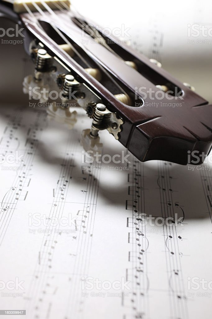 Guitar on Sheet Music stock photo