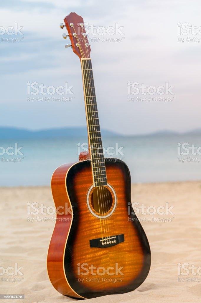 Guitar on the beach stock photo