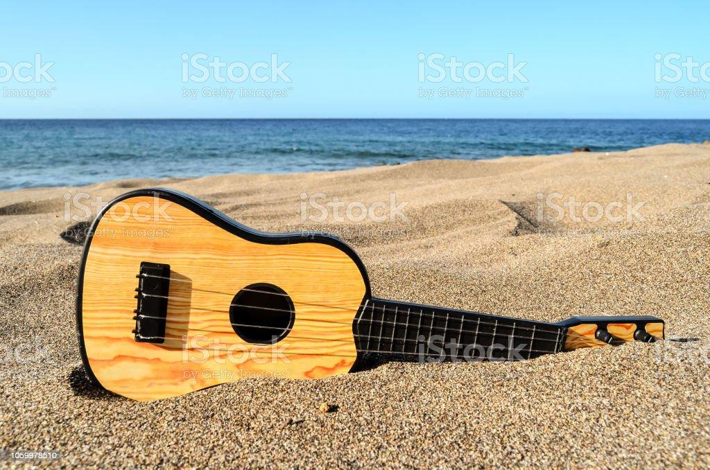 Guitar on the Sand Beach stock photo