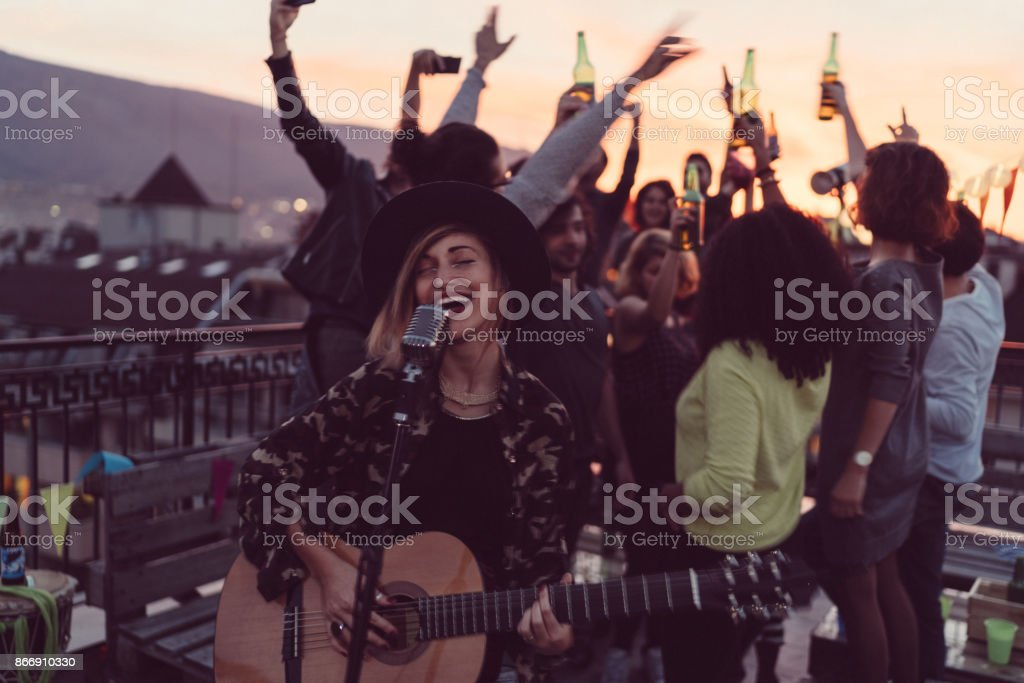 Guitar party on the rooftop stock photo