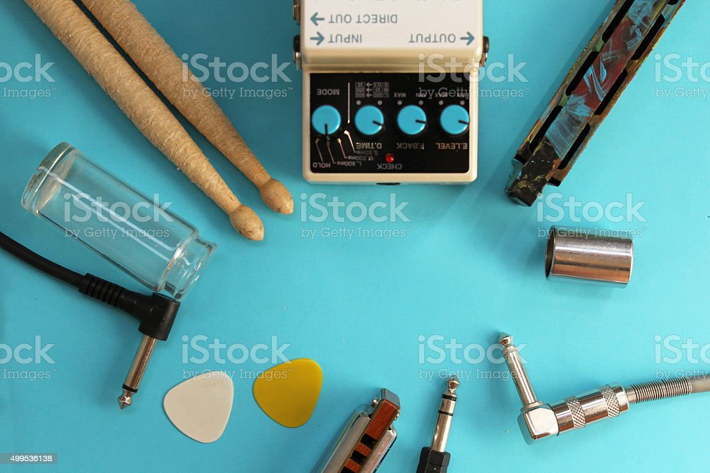 guitar pedal drum stick harmonica plug guitar slide and picks stock photo more pictures of. Black Bedroom Furniture Sets. Home Design Ideas