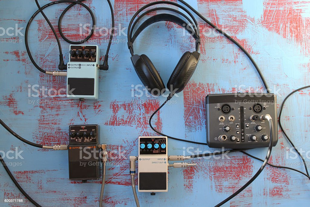 Guitar pedal, headset, and audio card - music concept zbiór zdjęć royalty-free
