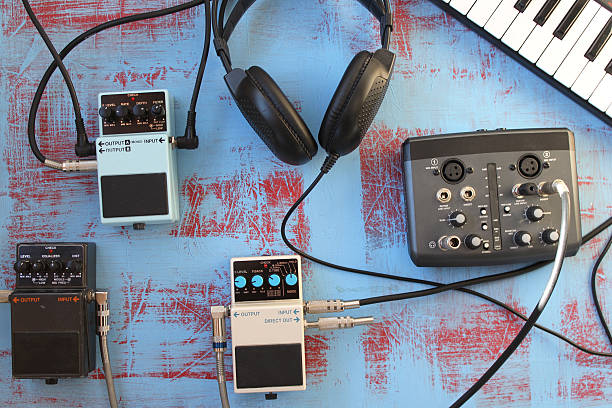 Guitar pedal, headset, keyboard and audio card - music concept圖像檔