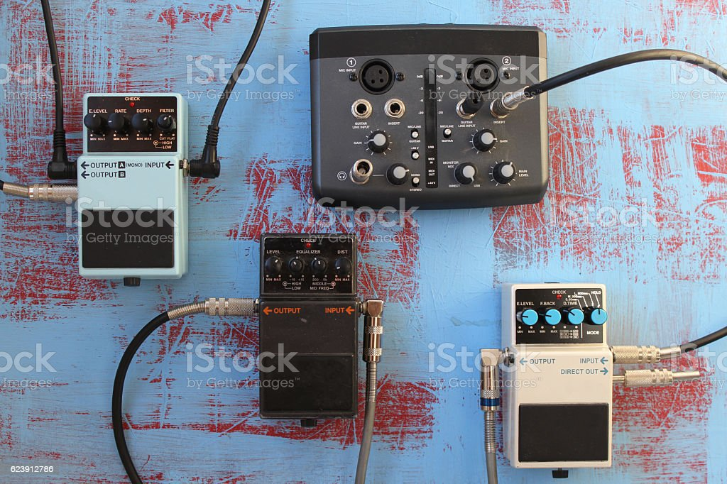 Guitar pedals and audio card for recording stock photo