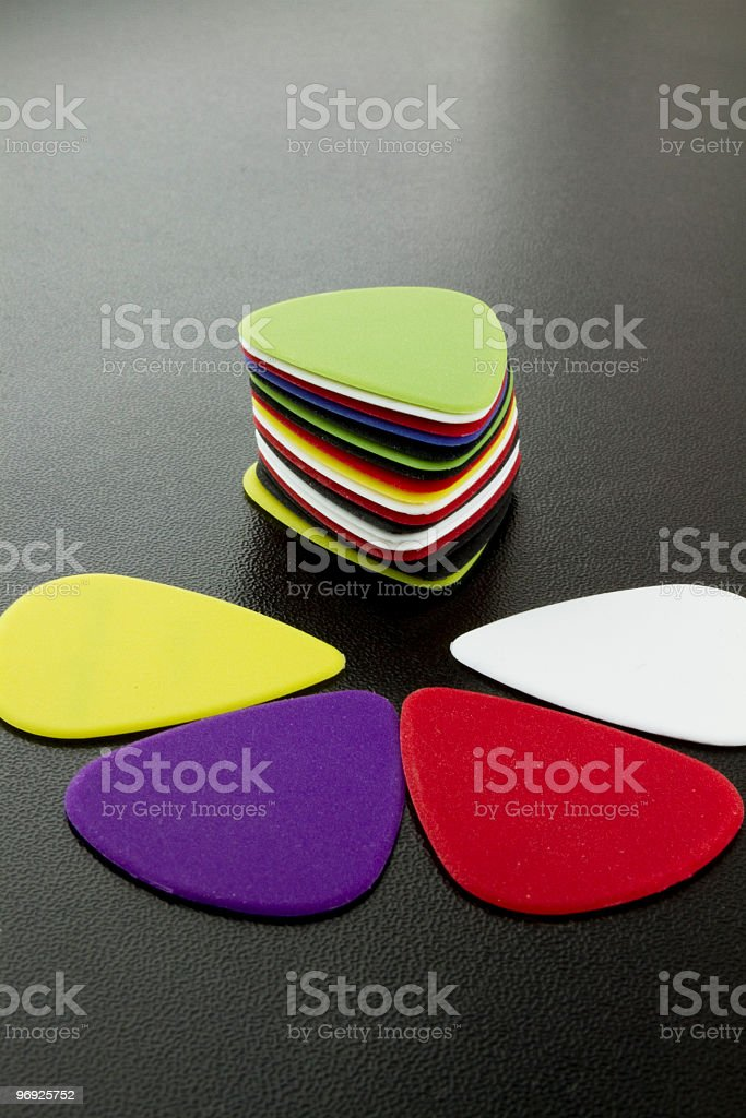 Guitar Picks on black background royalty-free stock photo
