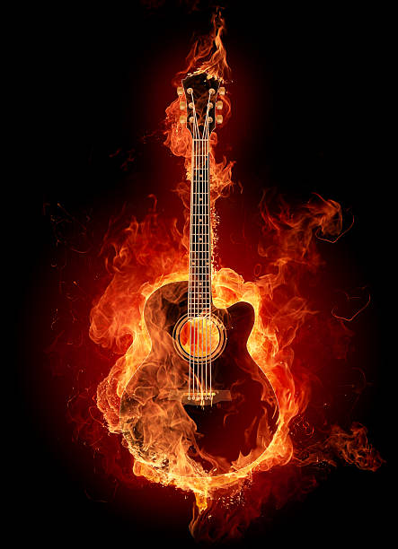 A guitar picture engulfed with fire stock photo