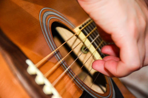 guitar Yellow-colored six-string guitar serenading stock pictures, royalty-free photos & images