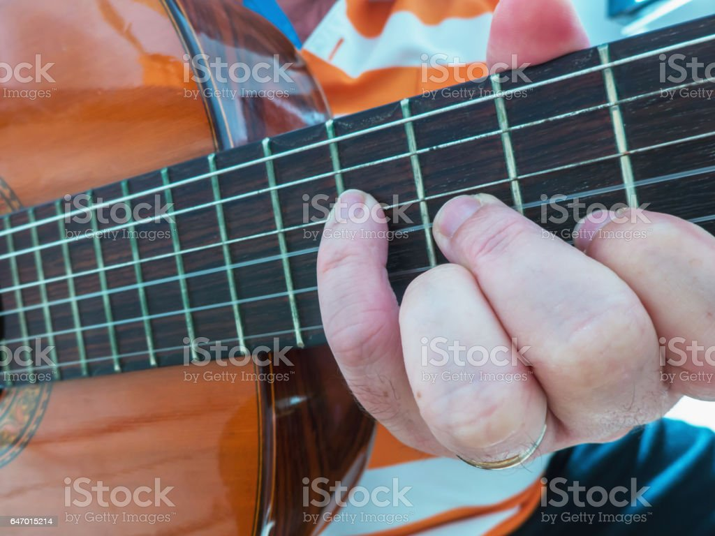 Guitar player detail stock photo