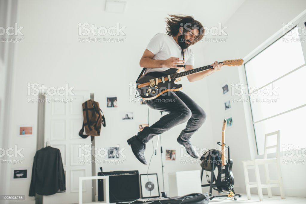 Guitar player having fun stock photo