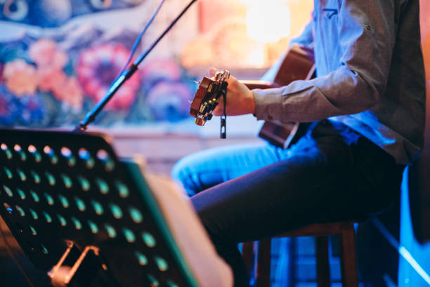 Guitar player in a café stock photo