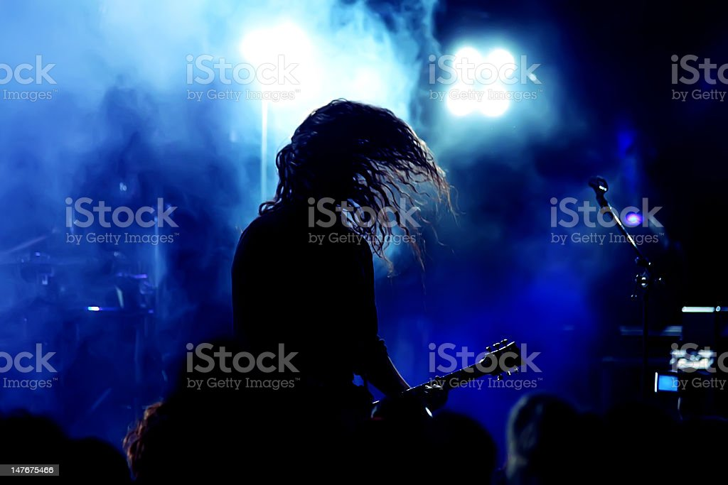 A guitar player in action in a gig stock photo