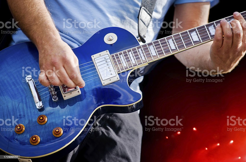 guitar player in action on stage royalty-free stock photo