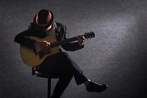 Guitar player on dark