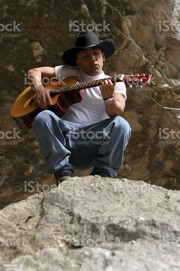 Guitar Player on Rock royalty-free stock photo