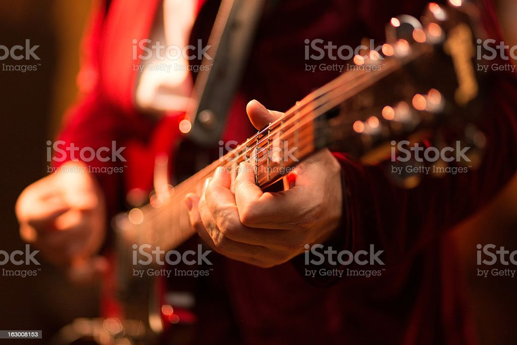 Guitar player on stage stock photo