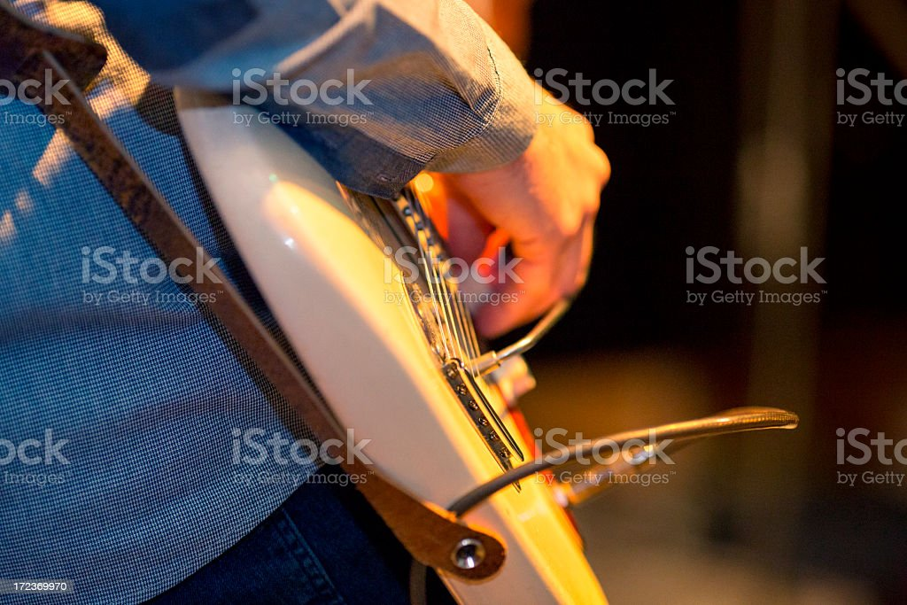Guitar player on stage royalty-free stock photo