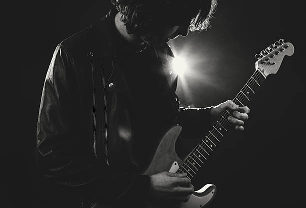 Guitar Player Guitar Player leather jacket stock pictures, royalty-free photos & images