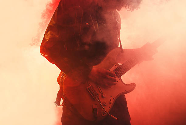 guitar player - rock music stock pictures, royalty-free photos & images