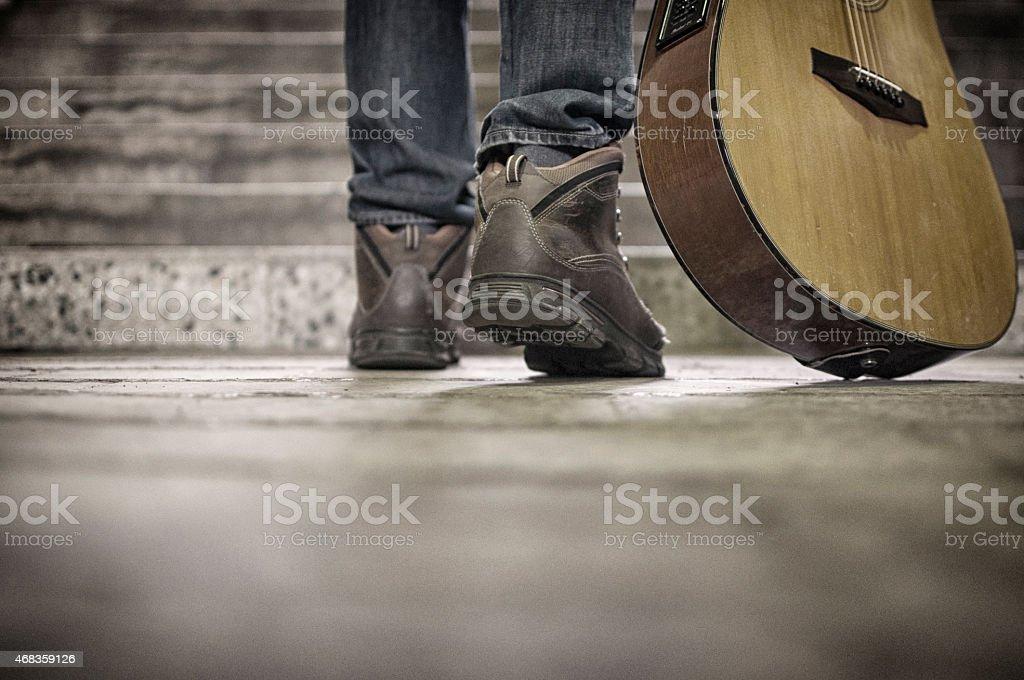 Guitar player walking royalty-free stock photo