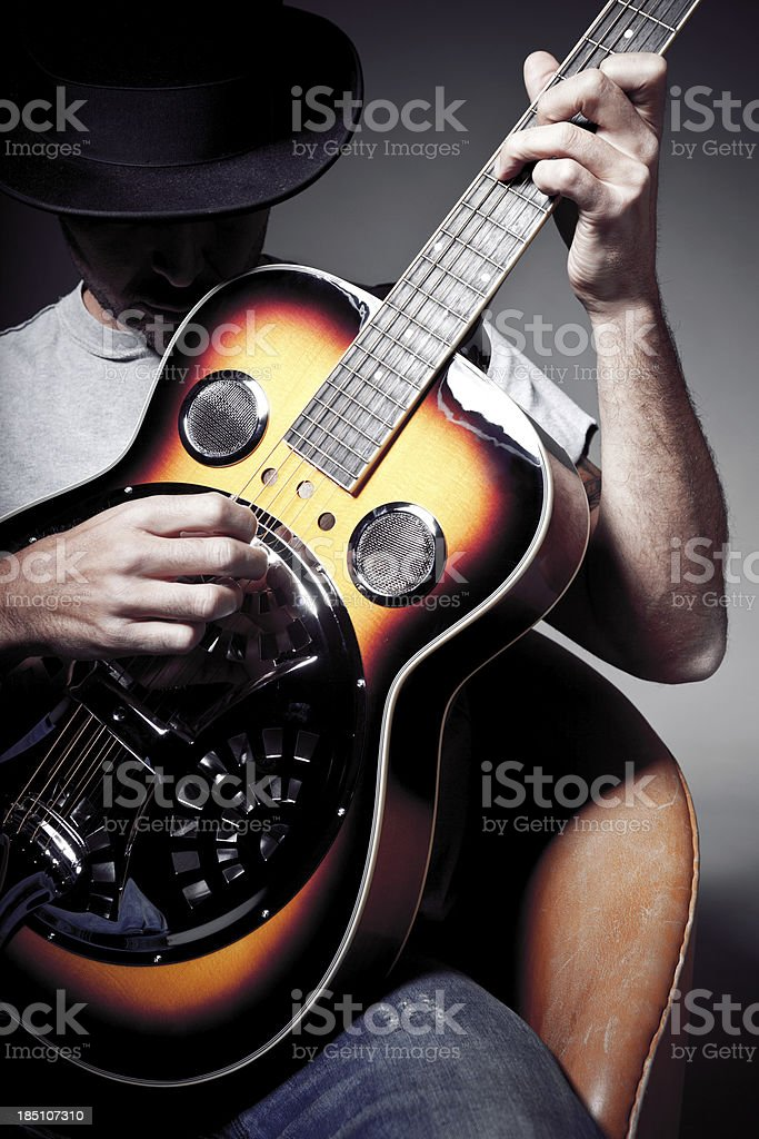 Guitar player with top hat stock photo