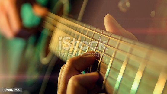 Play the guitar, man is playing the guitar, close up
