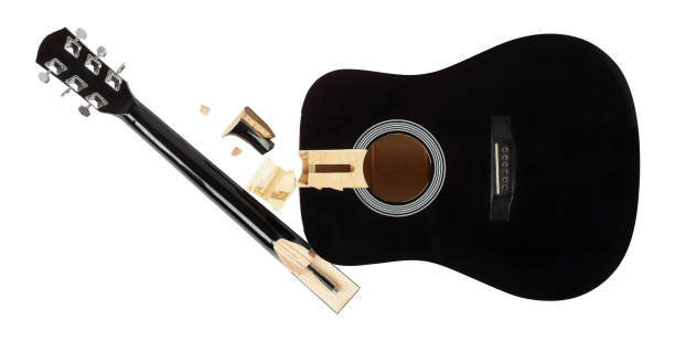 guitar repair and service - broken guitar isolated - broken guitar stock photos and pictures