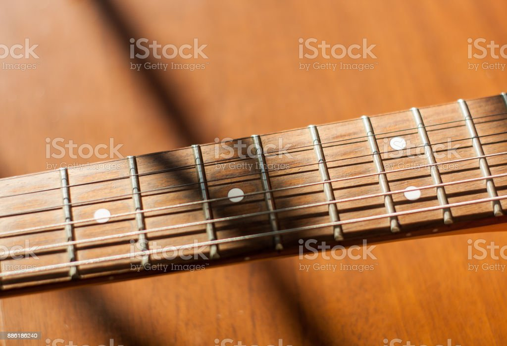 Guitar riff on wooden background stock photo