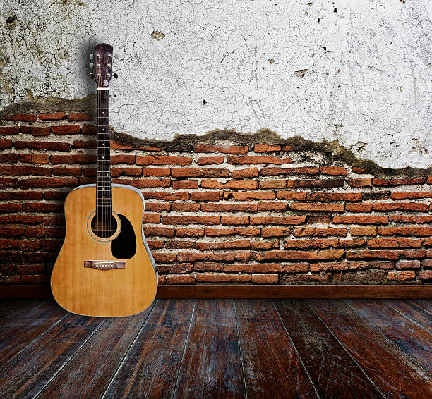 Guitar room Guitar in grunge room. folk music stock pictures, royalty-free photos & images