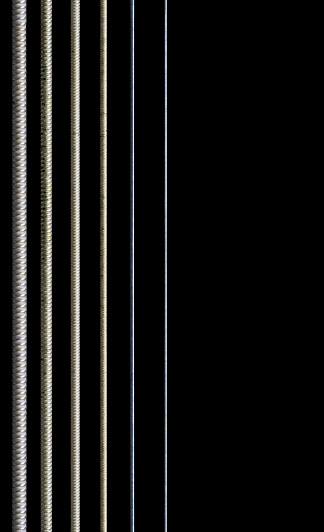 Macro Photo of curved end of mandolin fretboard in darkness and no body visable