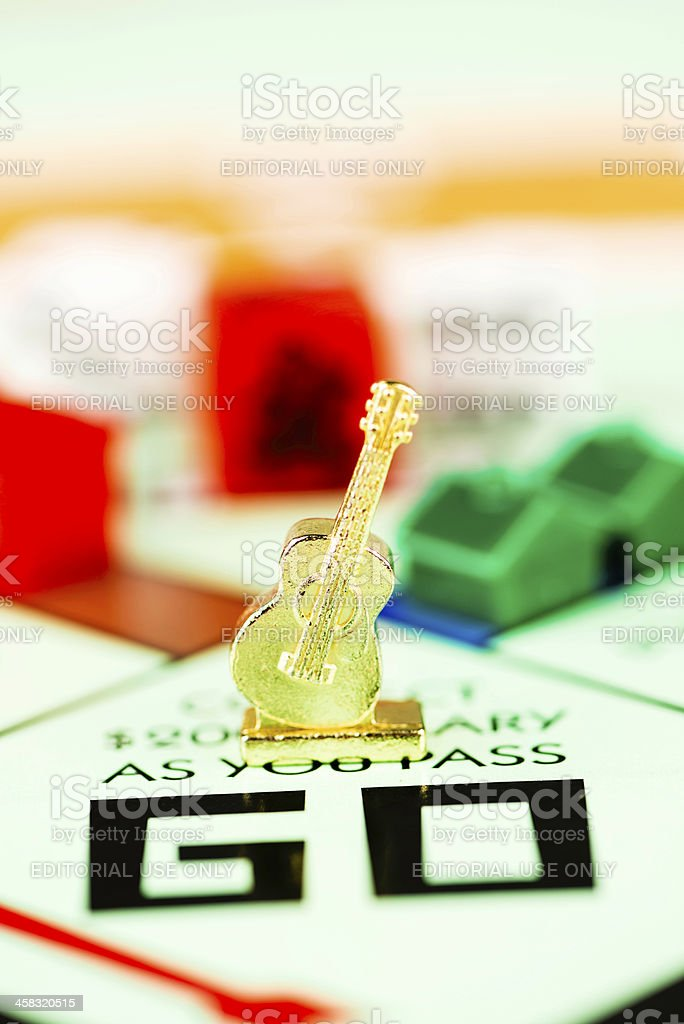 Guitar Token on Monopoly Board royalty-free stock photo