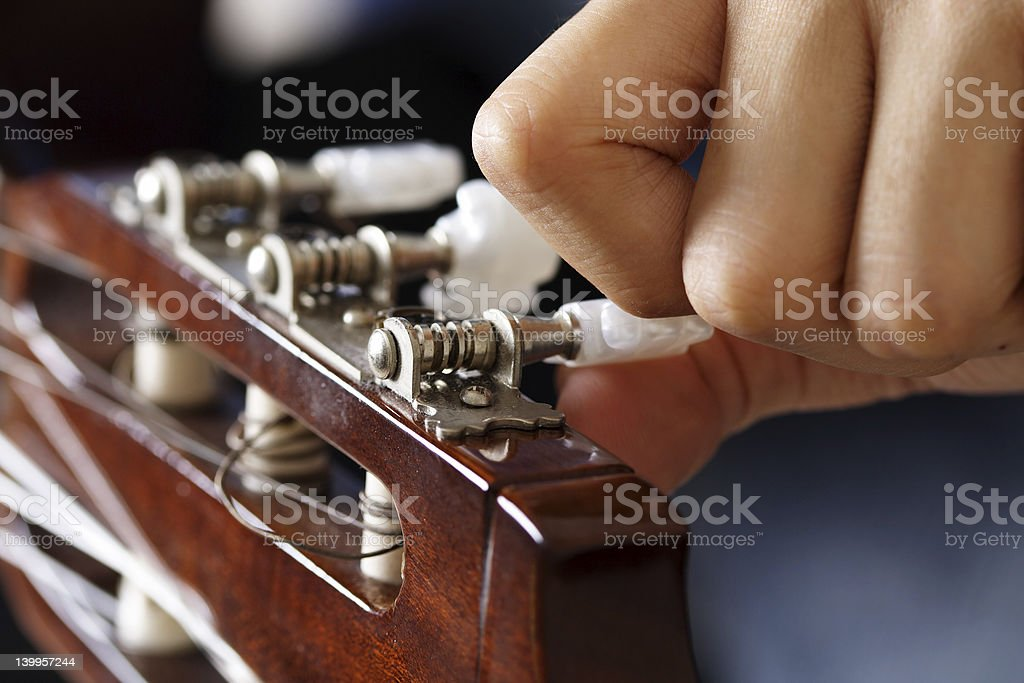 Guitar tuning royalty-free stock photo