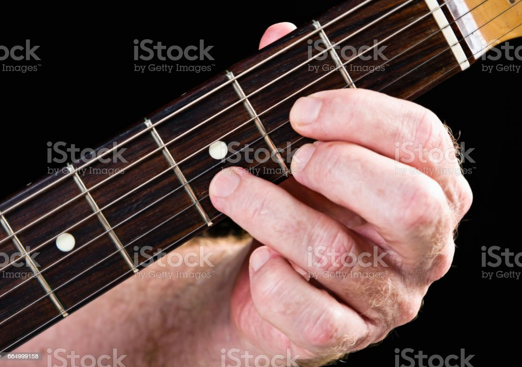 Guitar tutorial: D major chord demonstration on electric guitar stock photo
