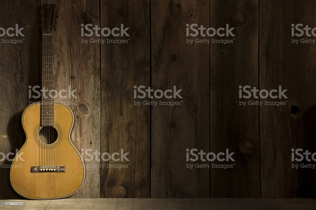 Guitar with barn wood background stock photo