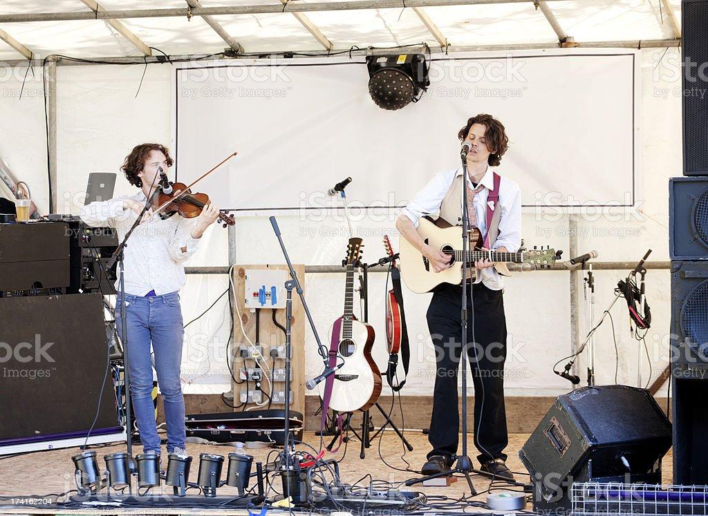 Guitarist and violinist stock photo