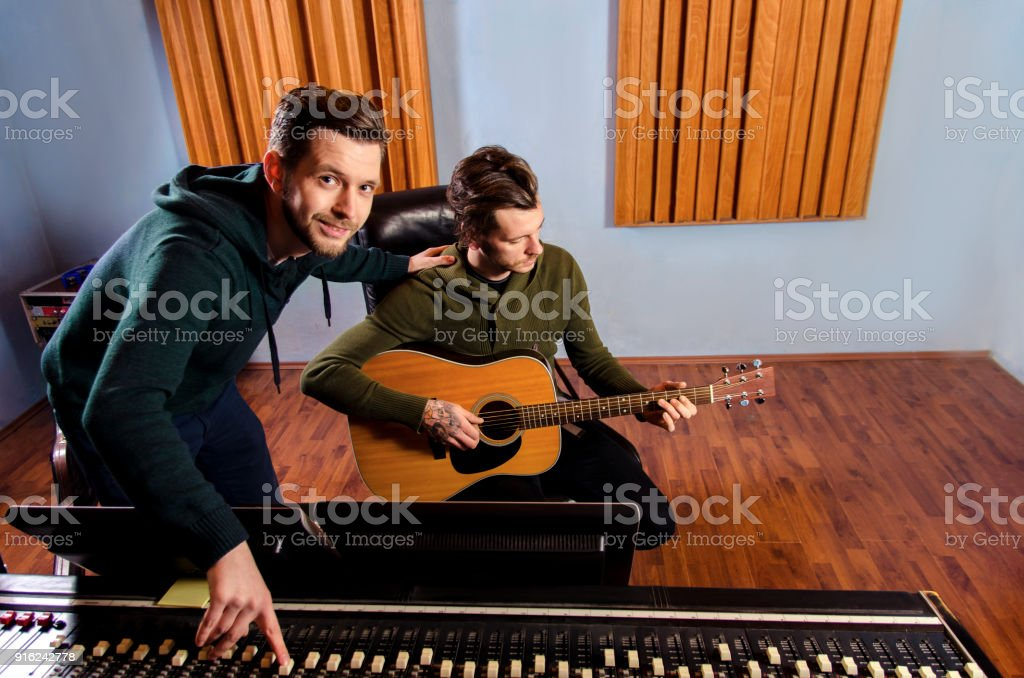Guitarist, artist and Music producer in studio stock photo