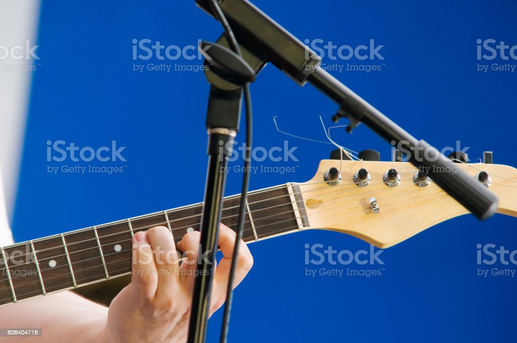 guitarist during the live performance on stage stock photo
