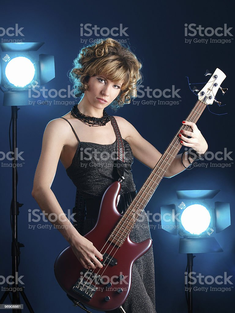 Guitarist in the light of projectors royalty-free stock photo