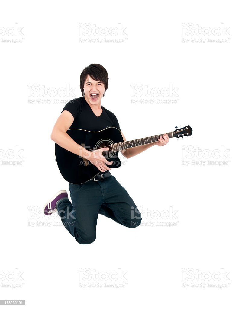 A guitarist jumping in the air royalty-free stock photo