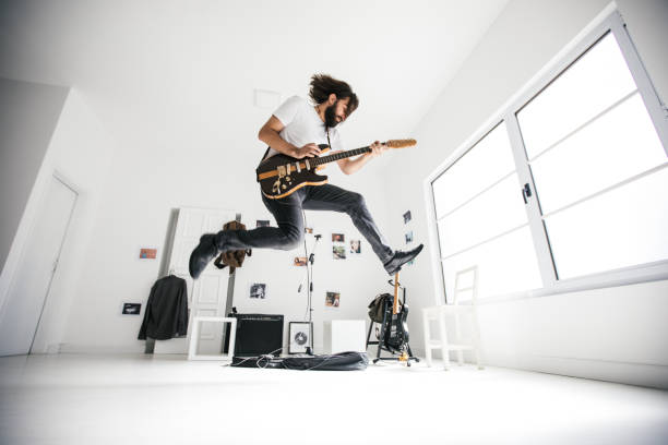 guitarist jumping - rock music stock pictures, royalty-free photos & images