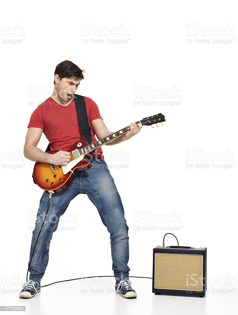 Guitarist man plays on the electric guitar stock photo