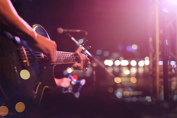 Guitarist on stage for background, soft and blur concept Guitarist on stage for background, soft and blur concept performing arts event stock pictures, royalty-free photos & images