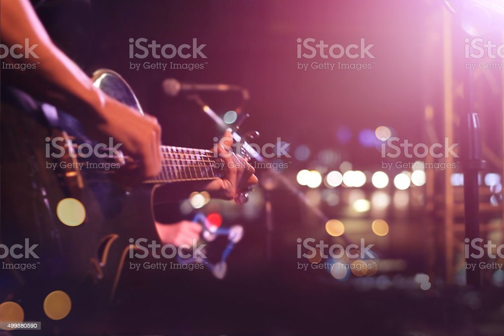 Guitarist on stage for background, soft and blur concept stock photo