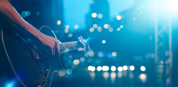 Guitarist on stage for background, soft and blur concept Guitarist on stage for background, soft and blur concept guitarist stock pictures, royalty-free photos & images