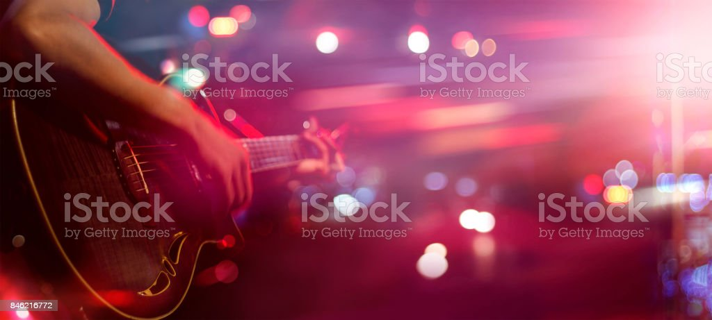 Guitarist on stage for background, soft and blur concept royalty-free stock photo
