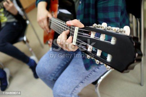 A closeup of a guitar fretboard