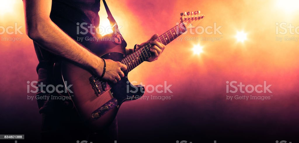 Guitarist playing a guitar, close-up stock photo
