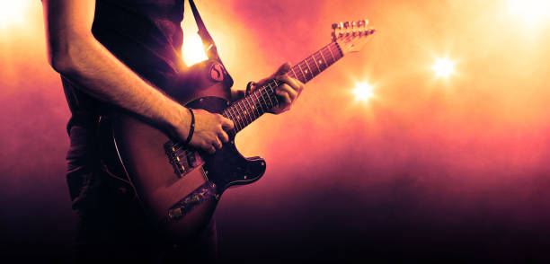 guitarist playing a guitar, close-up - rock music stock pictures, royalty-free photos & images