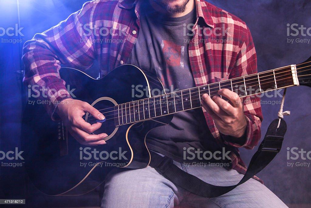 Guitarist playing guitar stock photo