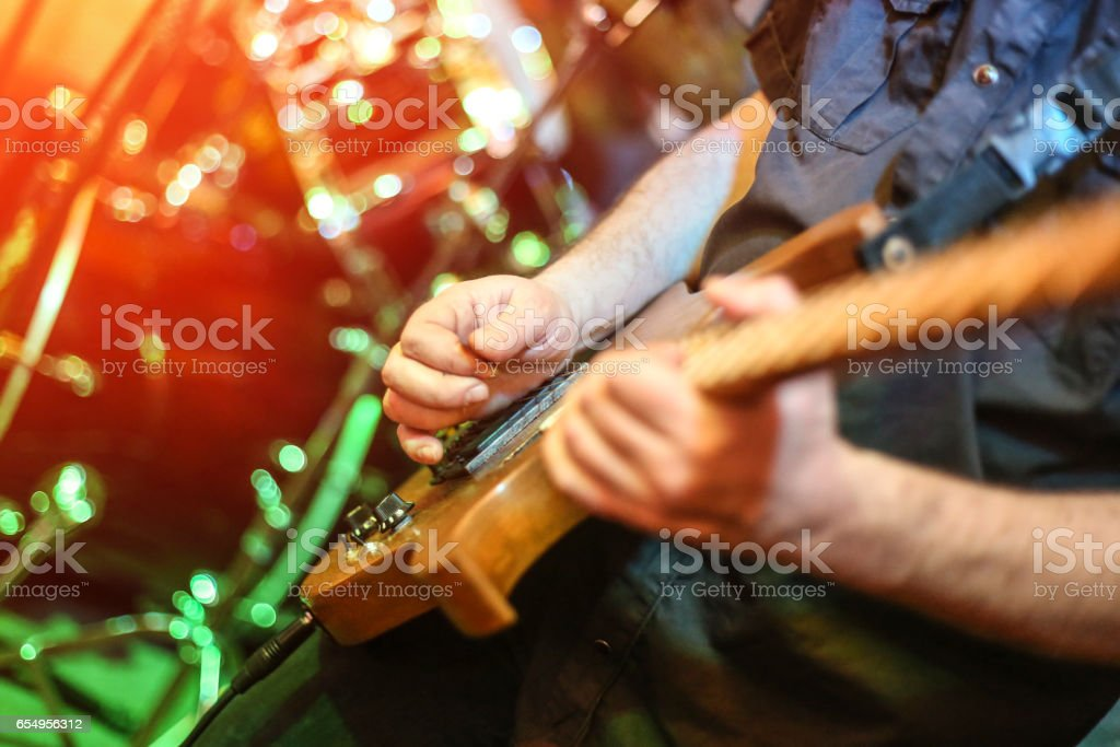 Guitarist playing in a concert stock photo