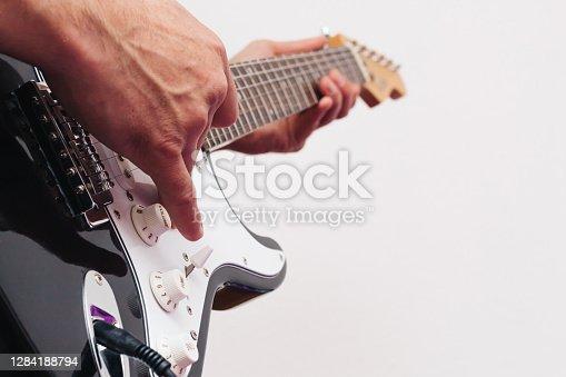 Guitarist playing musical instruments (focus on hand). pop, heavy, folk, grunge